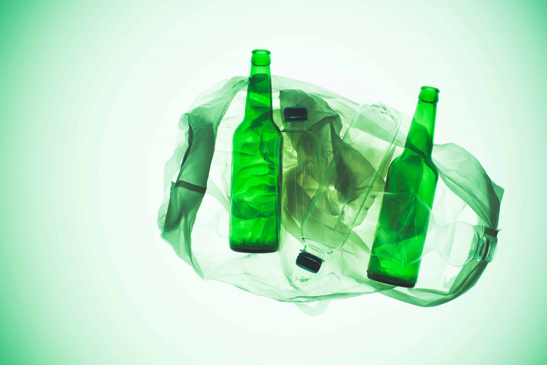 Glass bottles intertwined with a plastic bag