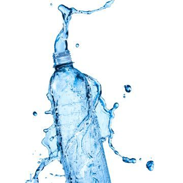 Water bottle with clean water and splash around it
