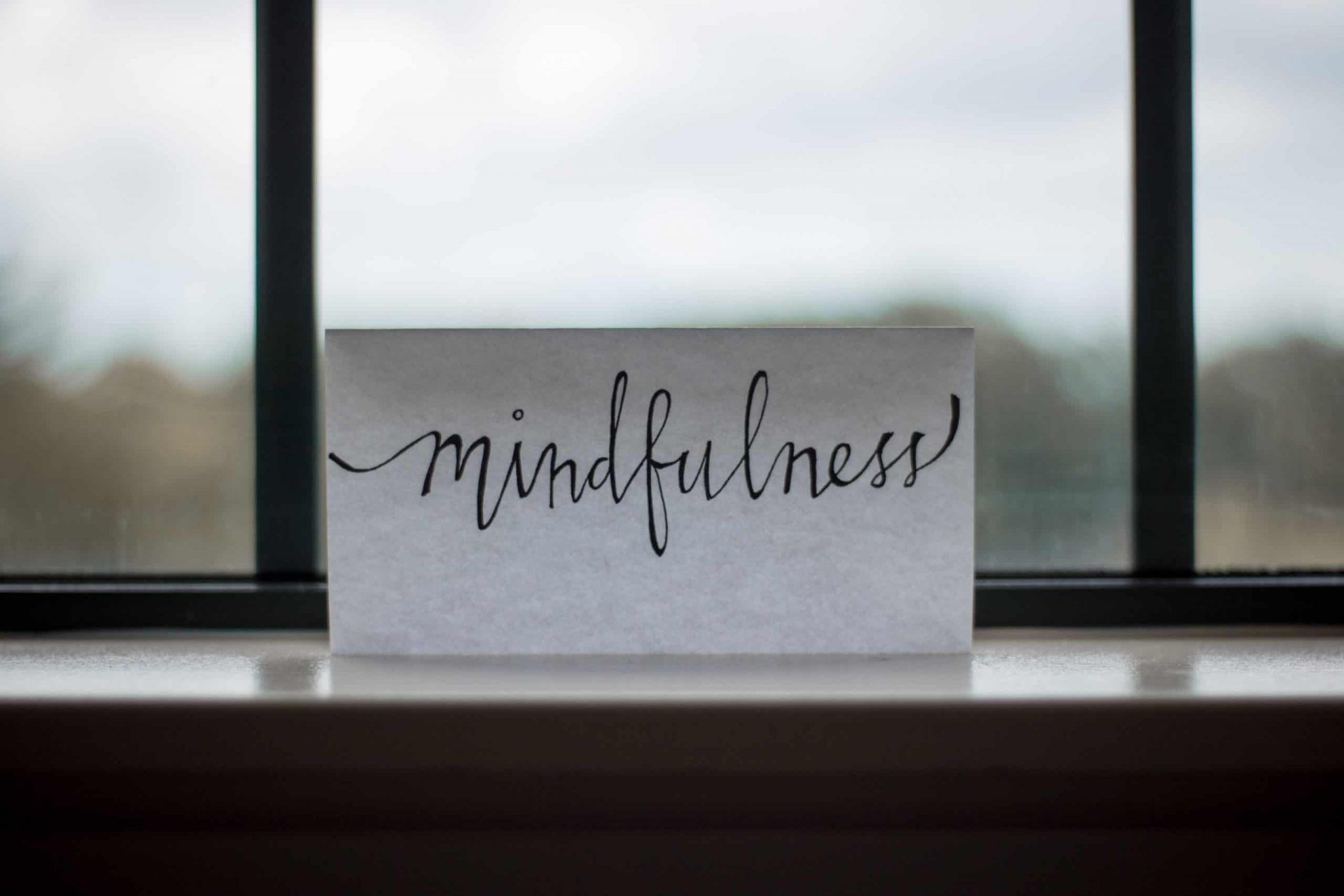 "image of piece of paper on a desk with words ""Mindfulness"""
